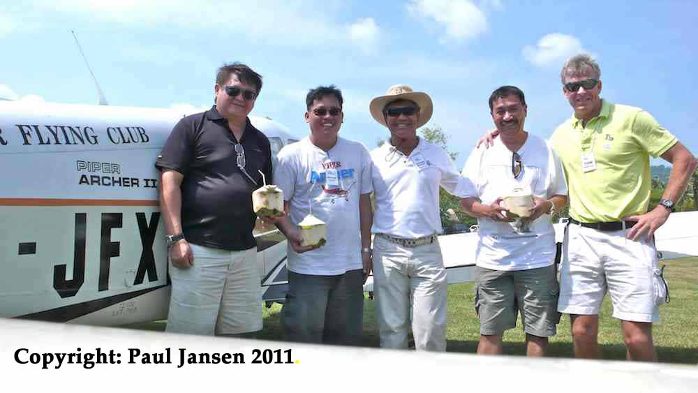 Phuket Airpark owner Suchard (3rd from left) greets JFC members (from left: Jeff Cheong, William Lee and Paul Jansen). Phuket resident Tom Claytor joins in (right). Copyright: Paul Jansen.