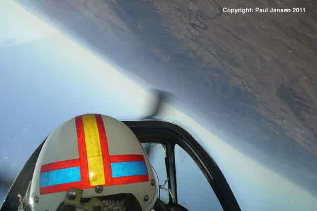 Paul Jansen puts the P-51D Mustang into a barrel roll, flipping the landscape north of Brisbane above the helmeted head of Captain Ed Field.