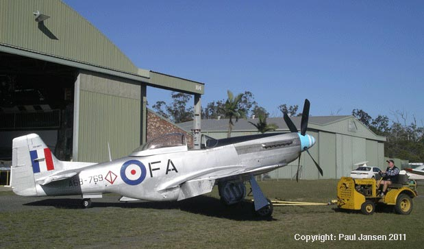 """Snifter"", an Australia-made Mustang P-51D World War II fighter being towed out of Caboolture Warplanes Museum for a flight by author Paul Jansen."