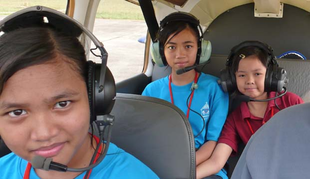 Disadvantaged children were given free rides aboard Johor Flying Club's aircraft. Copyright: Paul Jansen 2011.