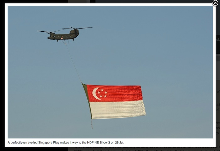 One of the centerpieces of the aerial display on National Day is the carriage of the flag. Picture @ Mindef