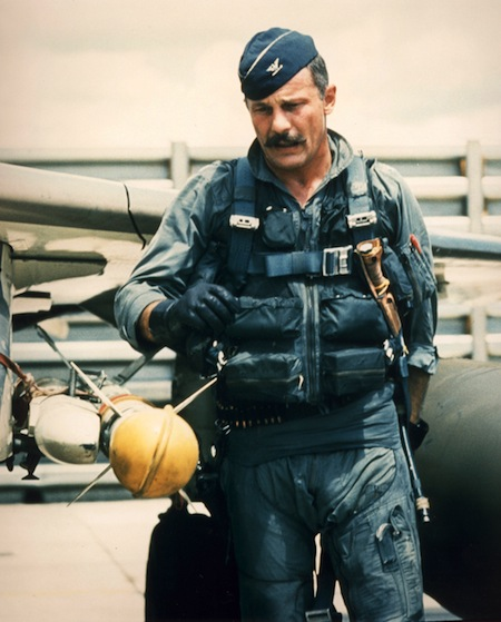 Robin Olds checks the Sidewinder on his Phantom F4 during the Vietnam War