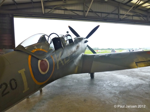 A restored Spitfire sits in the Boultbee Flying Academy hangar