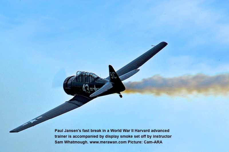 Harvard combat trainer aircraft spews smoke.