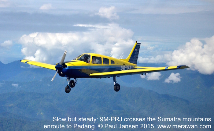 Piper Warrior II, 9M-PRJ, flies over Sumatra.