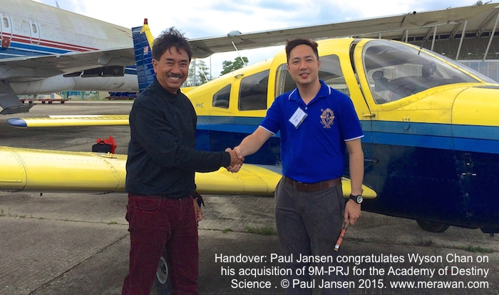 Paul Jansen hands over his Piper Warrior II, 9M-PRJ, to Wyson Chan.